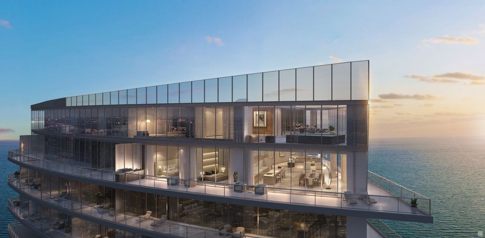 Rendering of Armani Casa Condos penthouse exterior evening.