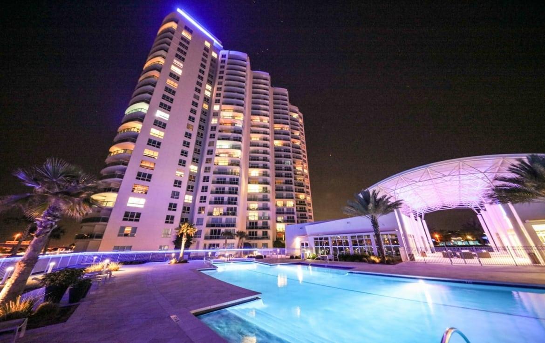 Marina Grande Daytona Building Exterior and Pool at Night